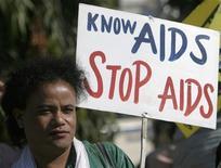 <p>Una prostituta durante una manifestazione per diffondere consapevolezza sull'Aids a Siliguri, nell'India nordorientale. REUTERS/Rupak De Chowdhuri (INDIA)</p>