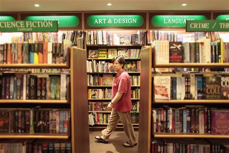 A woman walks at a bookstore in Shanghai August 13, 2009. REUTERS/Aly Song