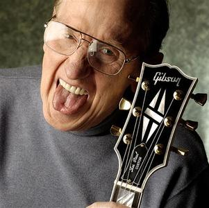 Les Paul, pioneering U.S. guitar player and leading innovator in guitar and electronics design, is shown in this undated publicity photo released to Reuters August 13, 2009. Martin/Gibson Guitars/Handout
