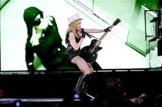 <p>U.S. pop singer Madonna performs during her Sticky and Sweet Tour concert at Ullevi stadium in Gothenburg, Sweden, August 8, 2009. REUTERS/Adam Ihse/Scanpix Sweden</p>