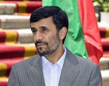 Iranian President Mahmoud Ahmadinejad waits fore starting a welcoming ceremony for Oman Sultan Qaboos bin Saeed in Tehran August 4, 2009. REUTERS/Raheb Homavandi