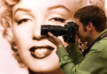 A photographer takes pictures at an exhibition of Marilyn Monroe property in a file photo. REUTERS/File