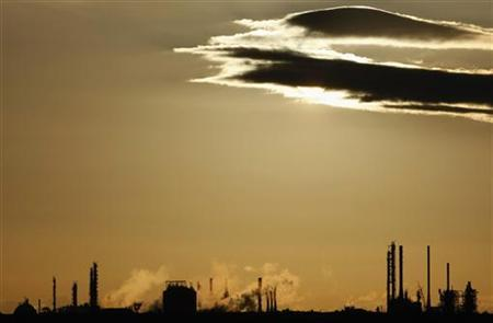 Steam and other emissions are emitted from funnels at a chemical manufacturing facility in Melbourne August 13, 2009. REUTERS/Mick Tsikas