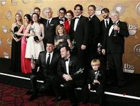 "<p>The cast of ""Mad Men "" pose after winning the award for Outstanding Performance by an Ensemble in a Drama Series at the 15th annual Screen Actors Guild Awards in Los Angeles January 25, 2009. REUTERS/Danny Moloshok</p>"