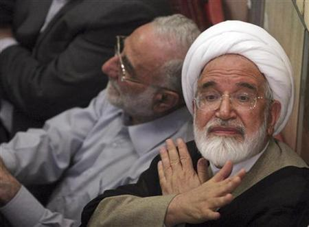 EDITORS' NOTE: Reuters and other foreign media are subject to Iranian restrictions on their ability to report, film or take pictures in Tehran. Iranian presidential candidate Mehdi Karoubi gestures to protesters gathered at the Ghoba mosque in northern Tehran June 28, 2009. REUTERS/via Your View