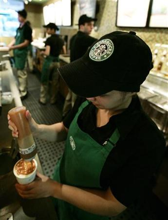 A Starbucks employee prepares a drink for a customer in their store on Sao Paulo's Alameda Santos June 11, 2008. REUTERS/Rickey Rogers