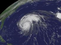 <p>Hurricane Bill is pictured moving in the Altantic Ocean in this satellite image taken August 21, 2009. REUTERS/NOAA/Handout</p>