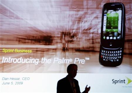 A Sprint executive is silhouetted during a news conference announcing the launch of the Palm Pre smartphone in New York June 5, 2009. REUTERS/Shannon Stapleton