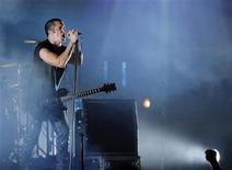 <p>Trent Reznor of music group Nine Inch Nails performs at the Voodoo Music Experience concert held at Riverview Park in New Orleans, Louisiana October 29, 2005. REUTERS/Lucas Jackson</p>