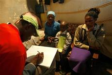 <p>An enumerator records details of a family participating in the national population census at the Kibera slum in Kenya's capital Nairobi, August 24, 2009. REUTERS/Thomas Mukoya</p>