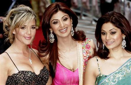 Bollywood actress Shilpa Shetty (C) poses with Celebrity Big Brother housemate Danielle Lloyd (L) and sister Shamita Shetty before the world premiere of ''Life in a.. Metro'' at the Empire cinema in London's Leicester Square, May 8, 2007. REUTERS/Luke MacGregor