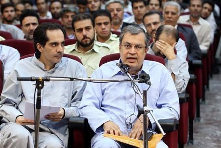 EDITORS' NOTE: Reuters and other foreign media are subject to Iranian restrictions on their ability to report, film or take pictures in Tehran. The architect of the Iranian reform movement Saeed Hajjarian (R) and Saeed Shariati, a key member of Mosharekat party, sit as defendants accused of acting against national security in a courtroom in Tehran August 25, 2009. Iran put prominent reformers in the dock on Tuesday, official media reported, in its fourth mass trial of people accused of orchestrating unrest after June's disputed presidential election. REUTERS/Fars News/Hasan Ghaedi