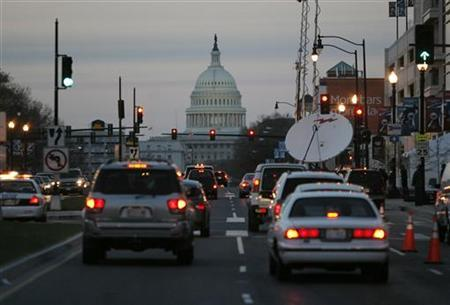 Traffic drives towards the U.S. Capitol building in Washington, March 29, 2008. REUTERS/Jason Reed