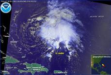<p>Tropical Storm Danny is seen 445 miles (716 km) west of the Bahamas in this National Oceanic and Atmospheric Administration (NOAA) satellite image taken at 1500 GMT on August 26, 2009. REUTERS/NOAA</p>