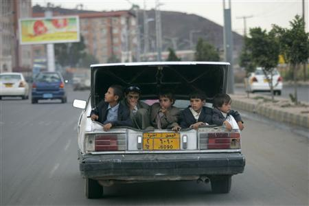 Boys sit in the trunk of a taxi during an excursion in Sanaa August 27, 2009. REUTERS/Khaled Abdullah