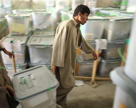 Afghan men transport a ballot box at the Independent Election Commission in Kabul on August 25, 2009. REUTERS/Goran Tomasevic