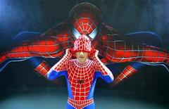 <p>A man puts on a Spider Man outfit to promote the Hollywood blockbuster 'Spider-Man 2' in Shanghai, August 2, 2004. REUTERS/China Photos</p>