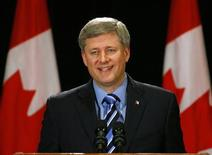 <p>Canadian Prime Minister Stephen Harper smiles after he announced that Calgary will host the Inter-American Development Bank meeting in 2011 at a news conference in Calgary September 1, 2009. REUTERS/Todd Korol</p>