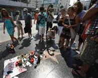 <p>People gather around the star of the late Michael Jackson on the Walk of Fame in Hollywood, California September 2, 2009. Jackson, who died aged 50 on June 25, 2009, will be buried on Thursday. REUTERS/Mario Anzuoni</p>