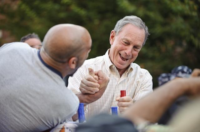 New York City Mayor Michael Bloomberg takes on 2nd Place winner Michael Selearis during a campaign stop at the 27th annual Arm Wrestling Championships in the Brighton Beach neighborhood of Brooklyn on August 30, 2009.  Your View/Jeff Bachner