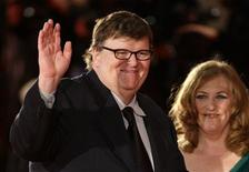 <p>U.S. director Michael Moore (L) and his wife Kathleen Glynn pose for photographers on the red carpet at the 66th Venice Film Festival September 6, 2009. REUTERS/Tony Gentile</p>