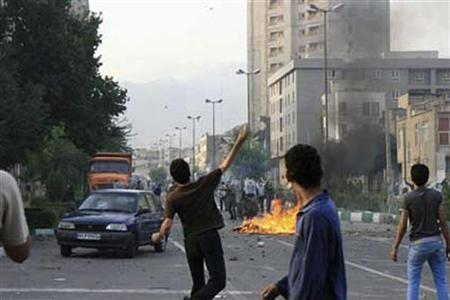 Supporters of defeated Iranian presidential candidate Mirhossein Mousavi clash with riot policeman in Tehran June 20, 2009. REUTERS via Your View