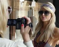 <p>U.S. socialite Paris Hilton is filmed by her personal photographer as she tours the Grand Hills hotel in Broumana, east of Beirut July 3, 2009. REUTERS/ Sherine Raffoul</p>