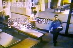 <p>Two men identified by authorities as Mohammed Atta (R) and Abdulaziz Alomari (C) pass through airport security on September 11, 2001. REUTERS/Portland Police Department/Handout</p>