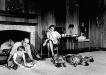 <p>Humphrey Bogart, Lauren Bacall, and their son, Stephen, with their pet boxers, Harvey, George, and Baby, in their living room at home in Los Angeles in a 1952 photo. REUTERS/© 1978 Sid Avery/MPTV.net/Handout</p>