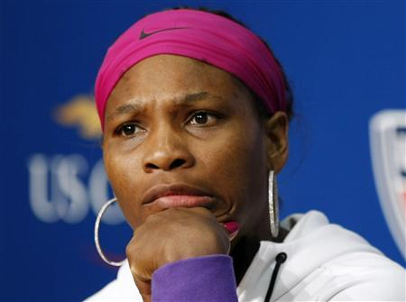 Serena Williams of the U.S. reacts to a question at a news conference following her loss to Kim Clijsters of Belgium in their semi-final match at the U.S. Open tennis tournament in New York, September 12, 2009. REUTERS/Kevin Lamarque
