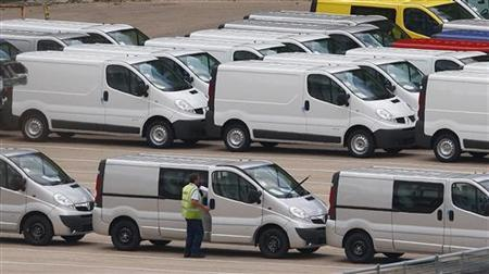 Vans are seen at the GM manufacturing plant in Luton, north of London, September 10, 2009. U.S. carmaker General Motors has decided to sell Opel to a group led by Canadian car parts maker Magna, ending months of uncertainty over the European unit's fate. REUTERS/Eddie Keogh