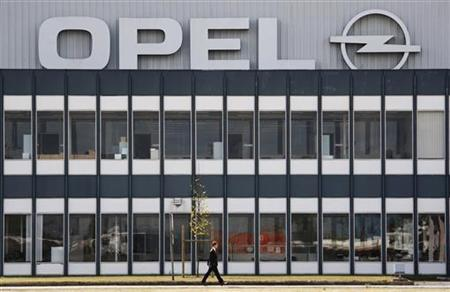 A man walks past the Opel assembly plant in Antwerp September 11, 2009. GM's board opted to sell Magna and its Russian partner Sberbank a 55 percent stake in Opel over a rival offer from Belgium-listed investor RHJ International. REUTERS/Francois Lenoir