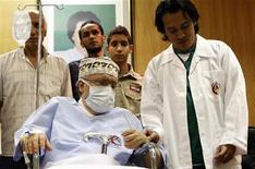 <p>Abdel Basset al-Megrahi sits in a wheelchair in his room at a hospital in Tripoli September 9, 2009. REUTERS/Ismail Zetouny</p>