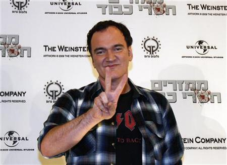 Director Quentin Tarantino gestures during a news conference ahead of the screening of his new film ''Inglourious Basterds'' in Tel Aviv, September 15, 2009. REUTERS/Gil Cohen Magen