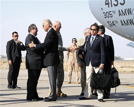 Vice President Joe Biden greets Iraqi Foreign Minister Hoshiyar Zebari as he arrives in Baghdad, September 15, 2009. REUTERS/Ross Colvin