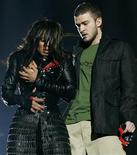 <p>Singer Janet Jackson performs with singer Justin Timberlake during the halftime show at Super Bowl XXXVIII in Houston, Texas, in this February 1, 2004 file photo. The U.S. Federal Communications Commission said on Tuesday the agency will review the incident involving a fleeting glimpse of pop singer Jane Jackson's breast during the 2004 American football championship.REUTERS/Win McNamee</p>