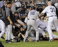 <p>Players of New York Yankees and Toronto Blue Jays get in a brawl during the eighth inning of their MLB American League baseball game at Yankee Stadium in New York September 15, 2009. REUTERS/Bill Kostroun</p>