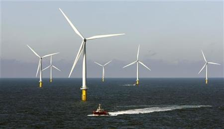 A crew boat passes through Horns Rev 2, the world's largest wind farm, 30 km (19 miles) off the west coast of Denmark near Esbjerg September 15, 2009. REUTERS/Bob Strong