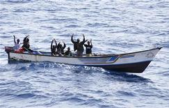 <p>Suspected Somali pirates raise their hands in their skiff during their arrest by Marines from NATO's Portuguese frigate Corte-Real in the Gulf of Aden June 22, 2009. REUTERS/NATO/Carlos Dias/Handout</p>