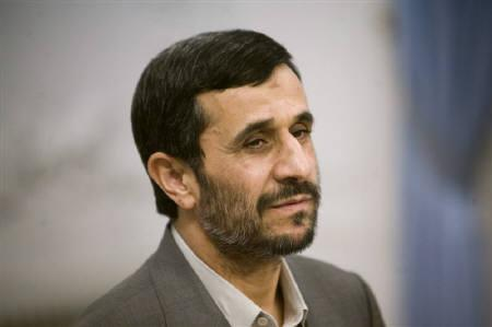 Iranian President Mahmoud Ahmadinejad looks on as he waits for a meeting with Turkish Foreign Minister Ahmet Davutoglu in Tehran September 12, 2009. REUTERS/Morteza Nikoubazl