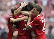 <p>Jogadores do Bayern Munich comemoram gol contra o Nuremberg. REUTERS/Michael Dalder</p>