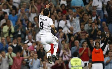 Real Madrid's Cristiano Ronaldo celebrates after scoring against Xerez during their Spanish first division match at the Santiago Bernabeu stadium in Madrid, September 20, 2009. REUTERS/Paul Hanna