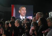 <p>Then President-elect Senator Barack Obama (D-IL) is pictured live on a giant screen as he addresses supporters at his election night rally in Chicago, November 4, 2008. REUTERS/Jason Reed</p>