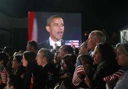 Then President-elect Senator Barack Obama (D-IL) is pictured live on a giant screen as he addresses supporters at his election night rally in Chicago, November 4, 2008. REUTERS/Jason Reed