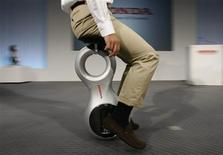 "<p>A Honda Motor Co employee demonstrates the company's prototype of new personal mobility device ""U3-X"" during its unveiling at the company headquarters in Tokyo September 24, 2009. REUTERS/Toru Hanai</p>"