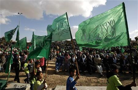Israeli Arab children march and wave Palestinian militant group Hamas' flags during a rally to mark Land Day in the southern Israeli city of Beersheva on March 28, 2009. REUTERS/Ammar Awad