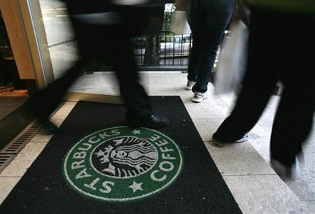 Starbucks customers walk out of the store on Sao Paulo's Alameda Santos June 11, 2008. REUTERS/Rickey Rogers