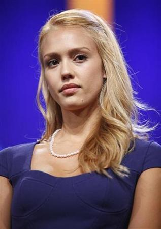 Jessica Alba stands onstage at the Clinton Global Initiative, in New York, September 24, 2009. REUTERS/Chip East