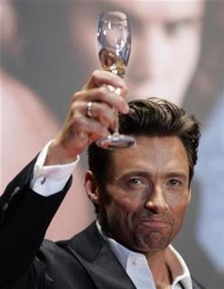 Actor Hugh Jackman with a glass of champagne gives a toasts to fans at a red carpet event for the Japan premiere of ''X-men Origins: Wolverine'' in Tokyo September 3, 2009. REUTERS/Michael Caronna