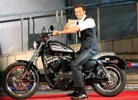 Actor Hugh Jackman poses on a Harley Davidson to fans before riding it at a red carpet event for the Japan premiere of ''X-men Origins: Wolverine'' in Tokyo, September 3, 2009. REUTERS/Kim Kyung-Hoon